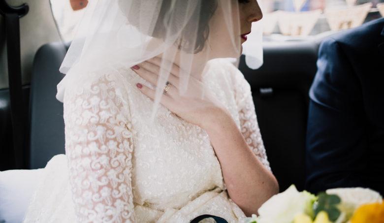 bride in black cab by Brighton pub wedding photography Lisa Jane Photography