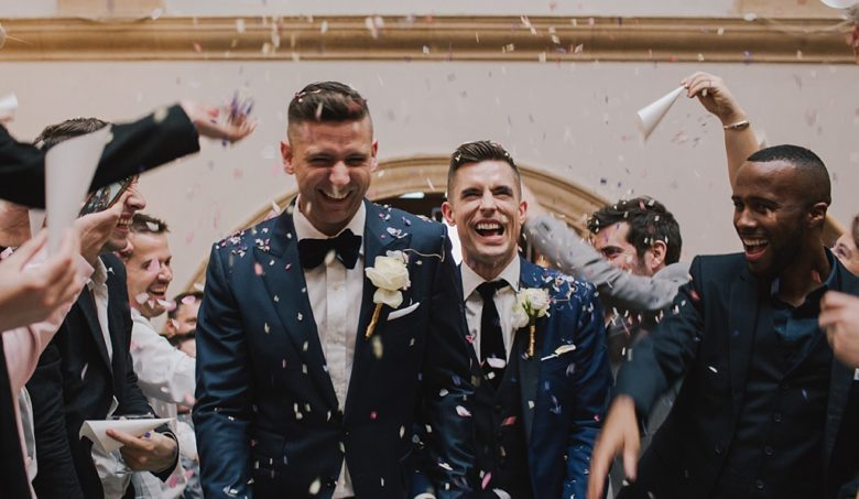 Two grooms showered with confetti at a Battersea ARts Centre Wedding by Lisa Jane Photography